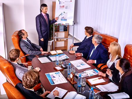 staff training: Happy group business people with chart in office. Staff training. Top view