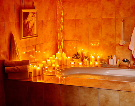 bubble bath: Home bathroom interior with bubble bath. Burning candels. Stock Photo