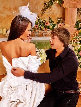 wedding night: Couple spend wedding night  at luxury spa. Man helps relieve girl dress.