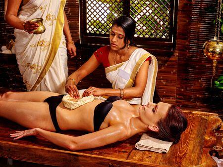 panchakarma: Young woman having stomach massage oil Ayurveda spa treatment.