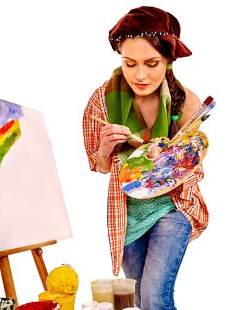 painter girl: Young woman artist at work near easel. Isolated. Stock Photo