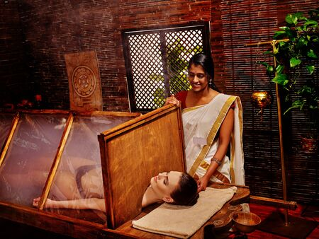 panchakarma: Woman having Ayurvedic sauna with steam treatment. Stock Photo