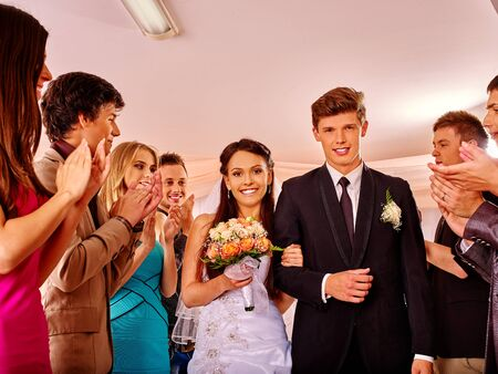 Happy group people claps  hands at wedding dance. photo