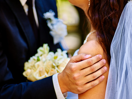body and part: Body part bride and groom holding flower summer  outdoor.