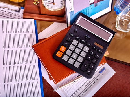 office life: Business still life with calculator on table in office. Stock Photo