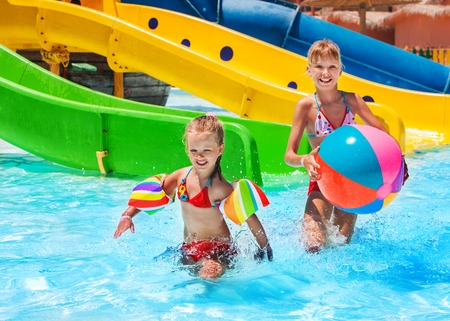 aqua: Child on water riding at aquapark. Summer holiday lifestyle. Stock Photo