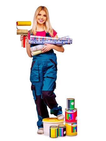 business tool: Builder blond young woman with roll wallpaper on isolated.