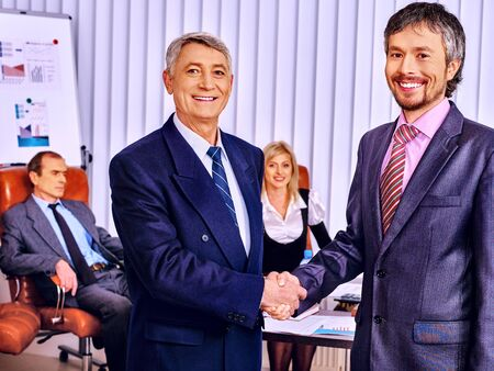 frendly: Happy group business people in office. Frendly handshake. Stock Photo