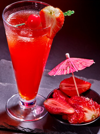 highball: Strawberry cocktail with cherry and pineapple in highball glass . Cocktail card 60. Stock Photo