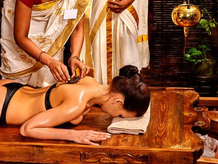 natural healing: Young woman having body Ayurveda spa massage.