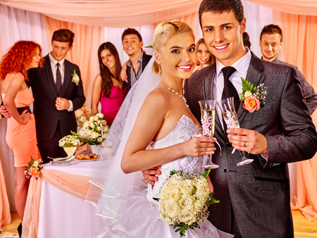 Happy wedding couple drinking champagne. photo