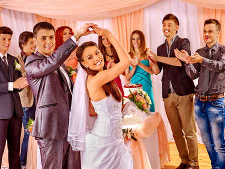 Happy group people at wedding dance. photo