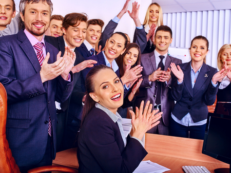 community work: Happy group business people with hand together in office. Stock Photo