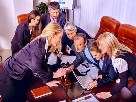 xerox: Happy group business people with chart in office. Stock Photo