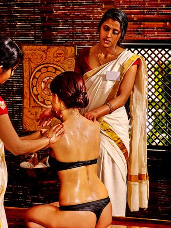 panchakarma: Sitting  woman having oil Ayurveda spa treatment. Stock Photo