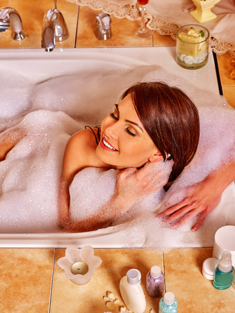 woman in bath: Woman relaxing at home luxury foam bath. Top view.