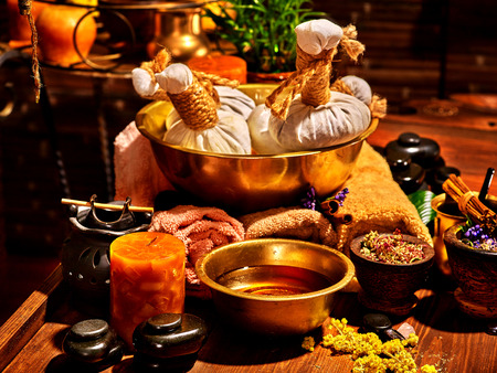 healing plant: Luxury ayurvedic spa massage still life. Oil and stone. Stock Photo