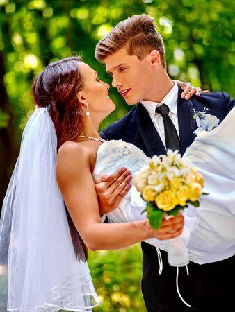 dress suit: Bride and groom in park summer  outdoor.