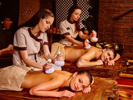 panchakarma: Young happy family  having oil Ayurveda spa treatment.