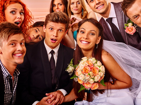 woman wedding: Bride and groom and guests in photobooth. Wedding. Stock Photo