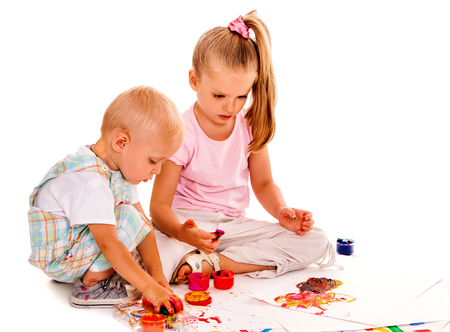 finger paint: Happy family with child painting by finger paint.