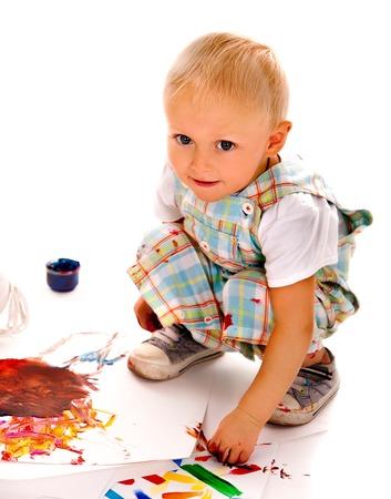 finger paint: Little boy painting by finger paint. Stock Photo