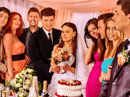 guests: Happy wedding couple and guests drinking champagne. Stock Photo
