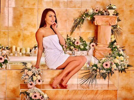 parlour: Woman relaxing at luxury water spa.