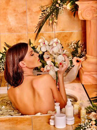 moisturizer: Woman with close up applying moisturizer at bathroom. Stock Photo