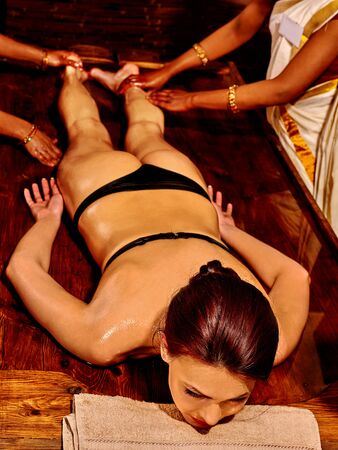 full lenght: Young woman full lenght having Ayurveda spa treatment.