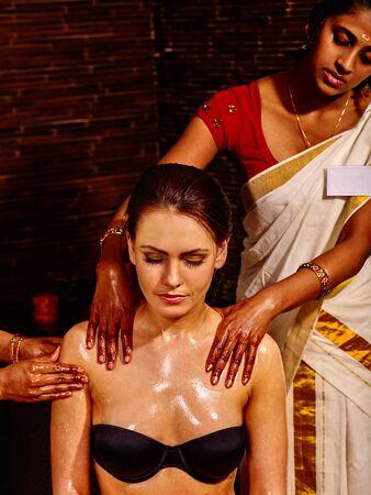 panchakarma: Young woman having neck and shoulders Ayurveda spa treatment.