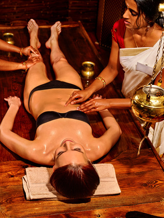 full lenght: Young woman full lenght having stomach Ayurveda spa treatment.