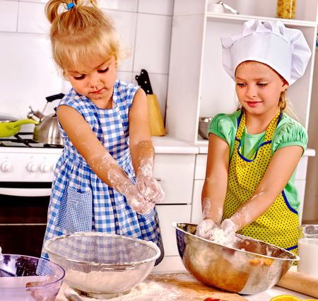 rollingpin: Girl kids  with rolling-pin dough at kitchen.