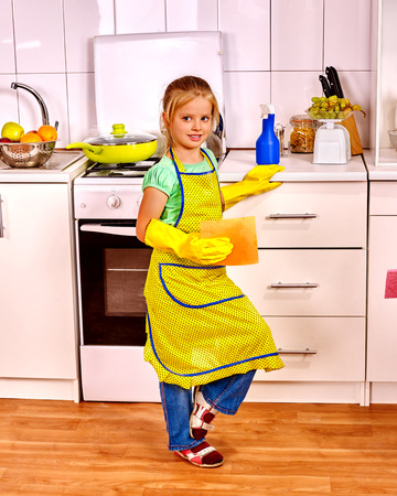 rubber: Children cleaning  kitchen. Happy small housekeeping with napkin .