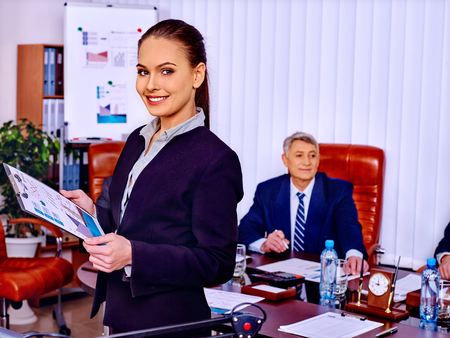 xerox: Happy group business people woman and man with chart in office. Stock Photo