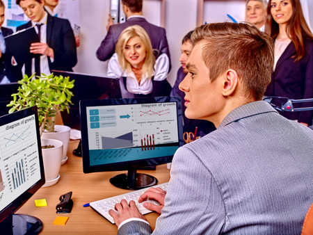 man working computer: Happy group business people together  in office. Stock Photo