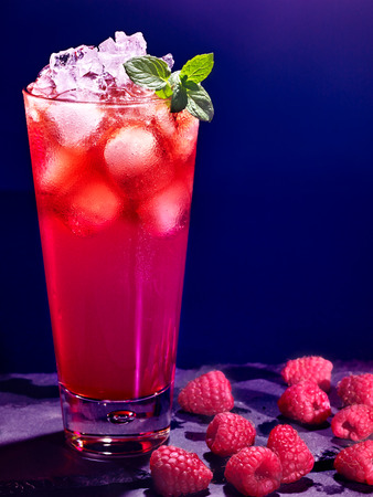 raspberries: Red raspberry drink  with ice mint cube on black background. Cocktail card 78.