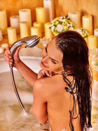 female in douche: Young woman take shower in bubble  bath. Stock Photo