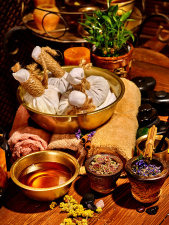 herbal massage ball: Luxury ayurvedic spa massage still life. Stone therapy. Stock Photo