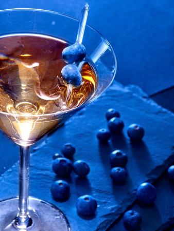 81: Blueberry gold drink on black background. Cocktail card 81