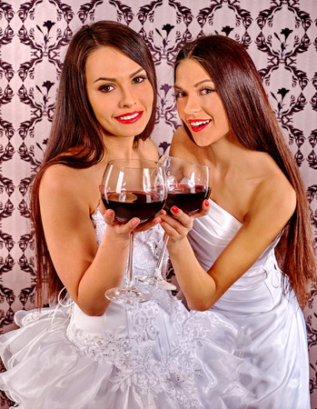 nude black girl: Two sexy lesbian women drinking red wine. Wallpaper background.