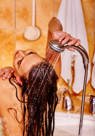 female in douche: Woman Wash hair with water