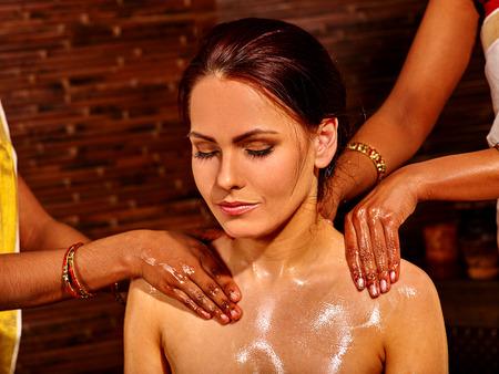 panchakarma: Young woman having neck Ayurveda treatment Stock Photo