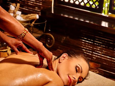 panchakarma: Young woman having oil Ayurveda treatment