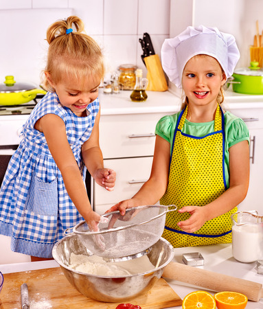 rollingpin: Child with rolling-pin dough at kitchen