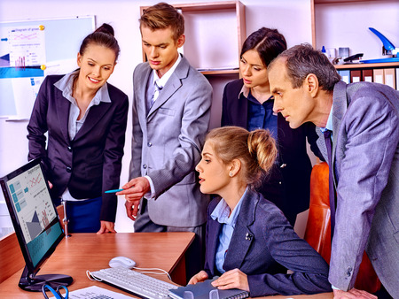 copier: Happy group business people with chart in office. Stock Photo