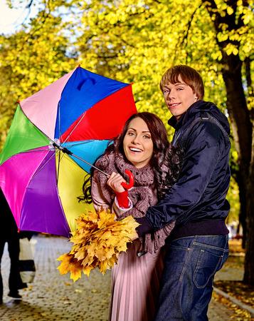 rain coat: Couple holding umbrella  autumn outdoor. Stock Photo