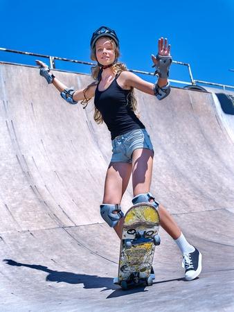 girl sport: Teen girl rides his skateboard outdoor.