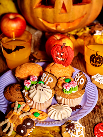Halloween table with trick or treat. Carving pumpkin Stock Photo