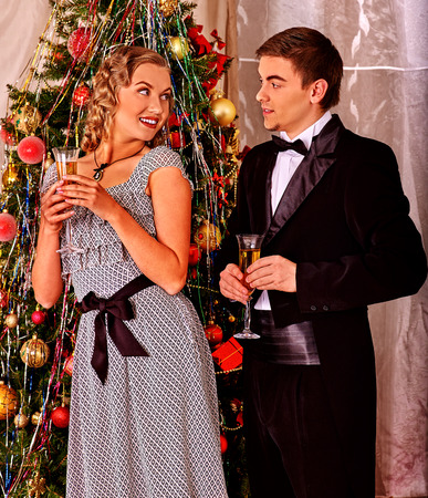 christmas party: Couple in party near Christmas tree